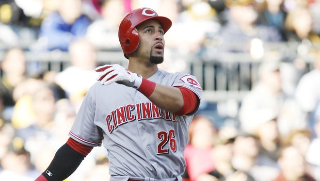Reds pinch hitter Xavier Paul hits a solo home run against the Pirates during the ninth inning.