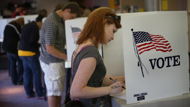 Student Courtney Johnson votes on the campus of the University of Northern Iowa on Friday.