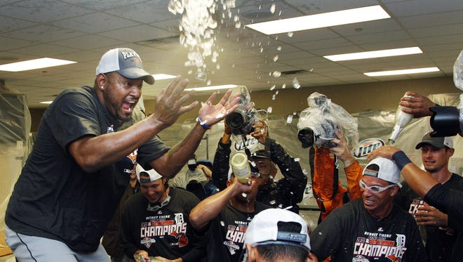 Jose Valverde, left, celebrates with teammates in the Tigers clubhouse after the team clinched the AL Central.