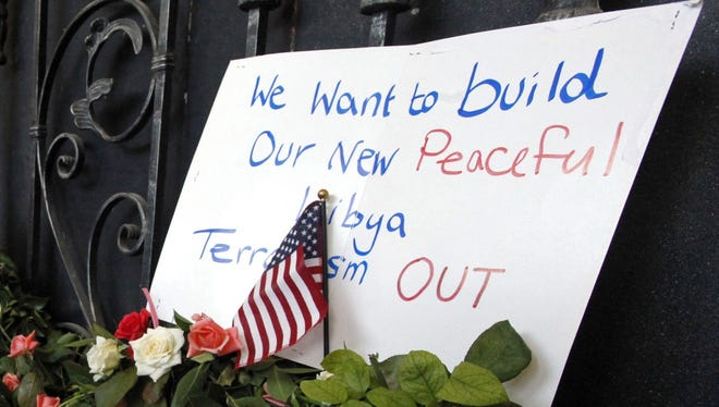 Libyans place flowers and other items at the U.S. Consulate in Benghazi last month.