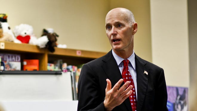 Florida Gov. Rick Scott reversed former governor Charlie Crist's decision to automatically restore voting and other rights of non-violent felons who served their sentences.