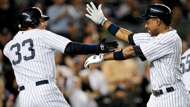 Curtis Granderson, right, is congratulated by Nick Swisher after hitting his 41st homer of the year in the second inning.