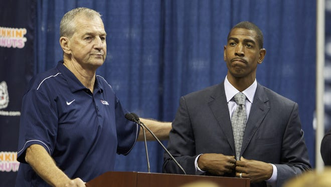 Former UConn coach Jim Calhoun, left, with new coach Kevin Ollie at a press conference announcing Calhoun's retirement on Sept. 13.