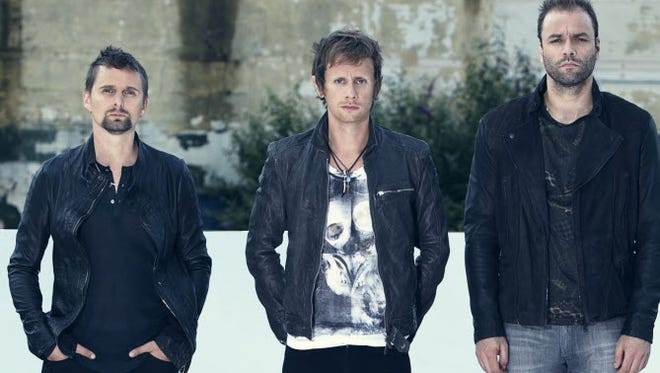 Muse: Matt Bellamy, left, Christopher Wolstenholme,  and Dominic Howard.