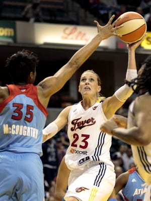 The Fever's Katie Douglas (23), shooting over the Dream's Angel McCoughtry, rebounded from a subpar Game 2 to score 24 points Tuesday, leading Indiana to the Game 3 win.