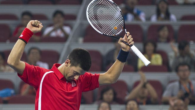 Novak Djokovic of Serbia celebrates after defeating Michael Berrer of Germany on Tuesday in the China Open.