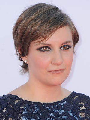 Lena Dunham arrives at the Emmys on Sept. 23. Salon reports that she's pitched a book of advice.