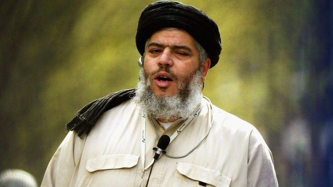 Radical Muslim cleric Abu Hamza al-Masri leads prayers outside the North London Central Mosque in 2004.