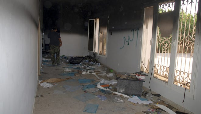 A man walks through a room in the gutted U.S. consulate in Benghazi, Libya, Sept. 12, after an attack that killed four Americans, including Ambassador Chris Stevens.