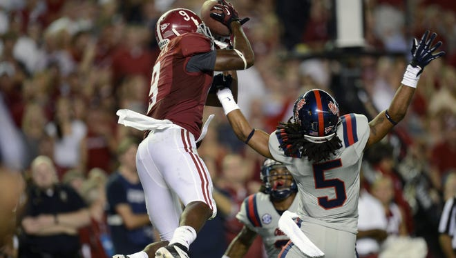 Alabama's Amari Cooper pulls in a touchdown pass over Mississippi's Frank Crawford in the Crimson Tide's 33-14 win over the Rebels.
