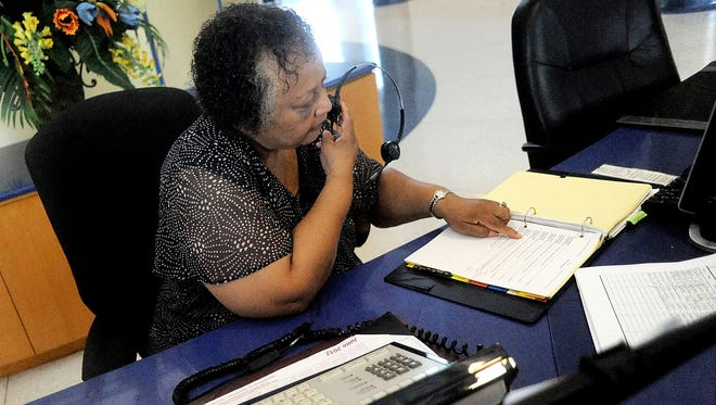 New hire Deloris Smith works the switchboard earlier this year at Southern University in Shreveport, La.
