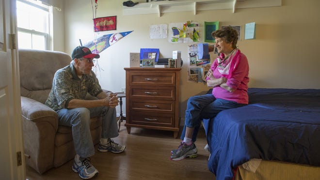 Carol Blackwell chats with her husband, Bob Blackwell, on Sept. 25 at the Great Falls Assisted Living facility in Herndon, Va. He has Alzheimer's disease.
