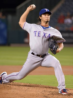 The Rangers will start right-hander Yu Darvish, above, against the Orioles Friday in Arlington, Texas. Darvish went 16-9 in his rookie season.