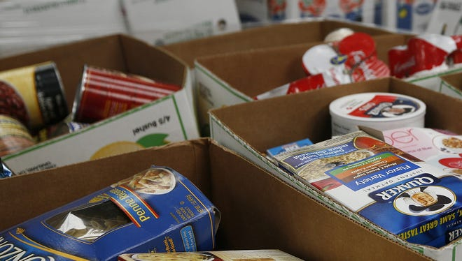 Food donated to the Treasure Coast Food Bank is seen in a warehouse  in Fort Pierce, Fla.