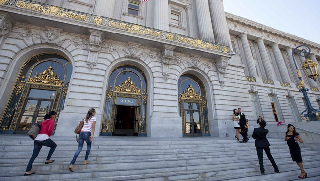 """People make their way up the steps to City Hall in San Francisco, where Sean Penn gave an impassioned speech in """"Milk."""""""