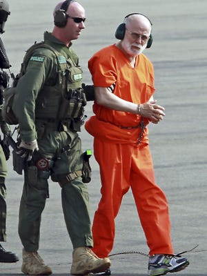 """Informant James """"Whitey"""" Bulger is escoted from a helicopter after a June 2011 court hearing in Boston. The FBI acknowledged its agents had allowed the accused mobster to run a crime ring in exchange for information about the mafia."""