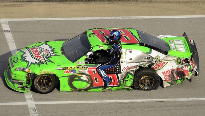 Dale Earnhardt Jr. (88) gives teammate Jimmie Johnson a ride to the start-finish line after Johnson's car was totaled on the last-lap crash in turns three and four at Talladega Superspeedway.