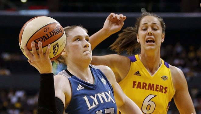 Lynx guard Lindsay Whalen, left, driving to the basket past the Sparks' Jenna O'Hea, tallied 17 point and five assists in Minnesota's 80-79 win.