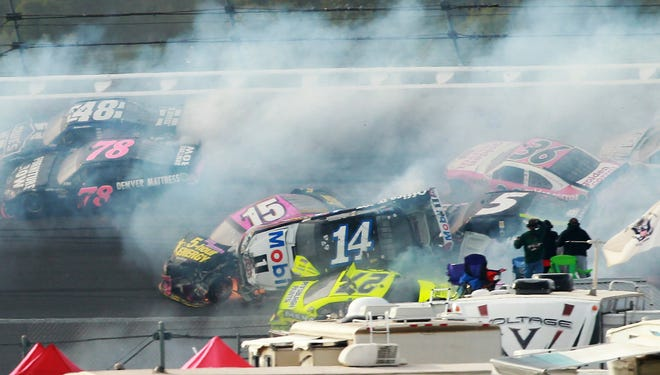 Tony Stewart (14) flips over Clint Bowyer (15), Paul Menard (27) and Kasey Kahne as he triggers a 25-car crash on the last lap of the Good Sam Roadside Assistance 500 at Talladega Superspeedway.