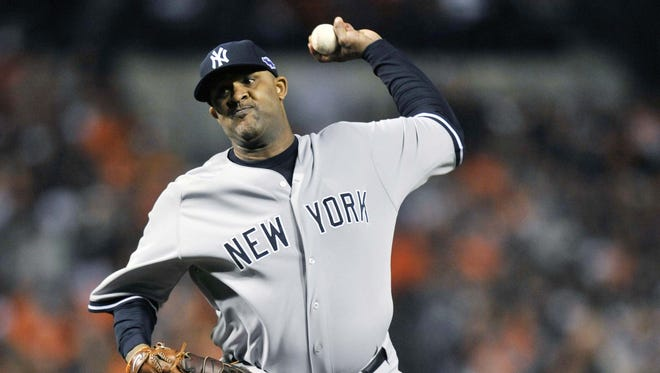 Yankees' CC Sabathia struck out seven over 8 2/3 innings for the win..