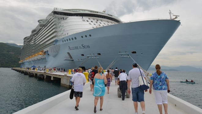 Passengers head back to Royal Caribbean's Allure of the Seas after a day at Labadee, Haiti.