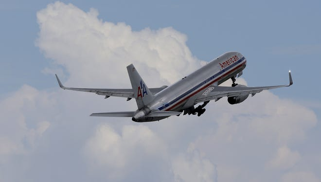 An American Airlines jet takes off from Miami International Airport on Sept. 27, 2012.
