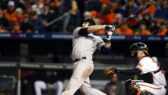 Yankees catcher Russell Martin belts a solo home run during the ninth inning to propel to New York to the Game 1 win over the Orioles.