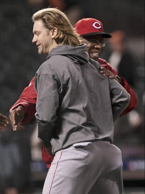 Bronson Arroyo and Reds manager Dusty Baker celebrate after Cincinnati's 9-0 win at AT&T Park.
