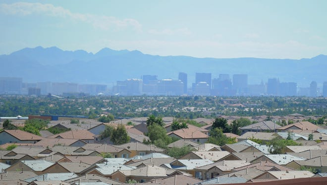 Houses in North West, a suburb of Las Vegas, seen in the background, and long ranked as the USA's foreclosure capital.