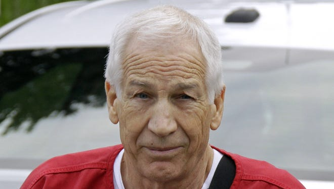 Former Penn State University assistant football coach Jerry Sandusky arrives for sentencing at the Centre County Courthouse in Bellefonte, Pa., on Tuesday.