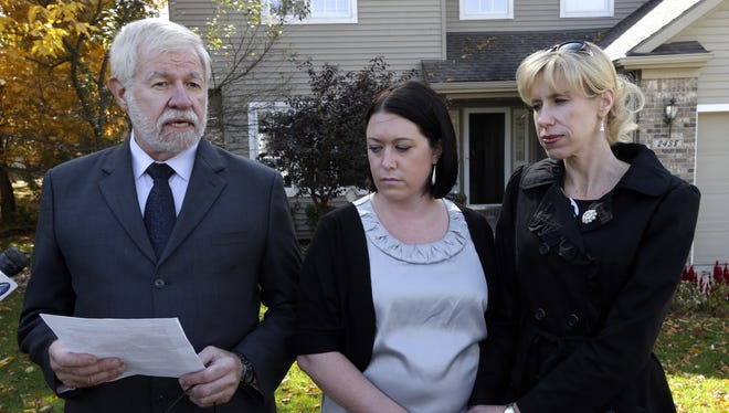 George Cary speaks with his daughters Heather Andrus, 33, center, and Jill Bloser, 43, on Tuesday. Cary's wife's death was linked to the national outbreak of fungal meningitis.