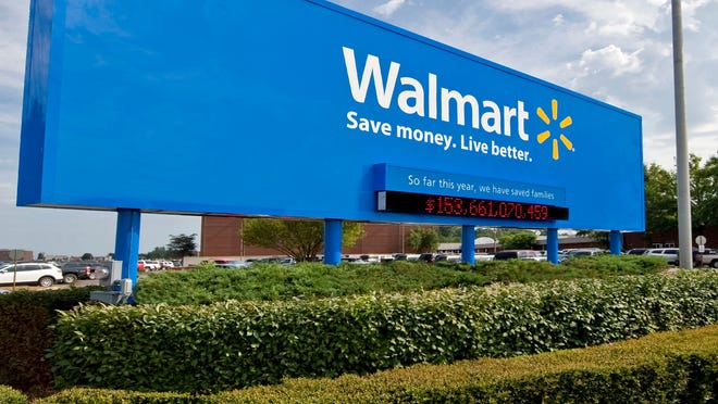 A sign in front of Wal-Mart Stores' headquarters in Bentonville, Ark.