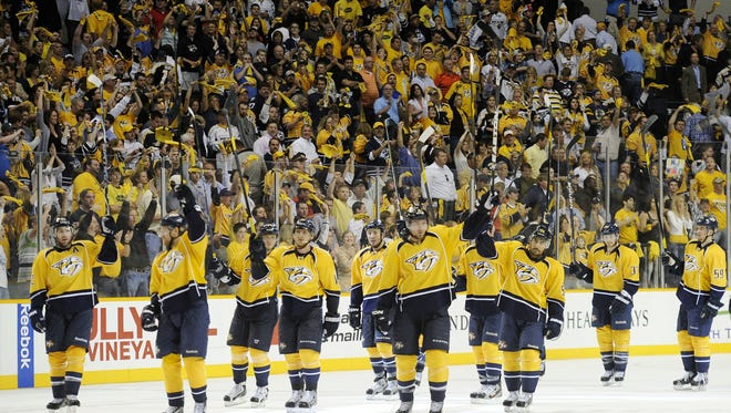 The small-market Nashville Predators salute the crowd after a playoff win during the spring.