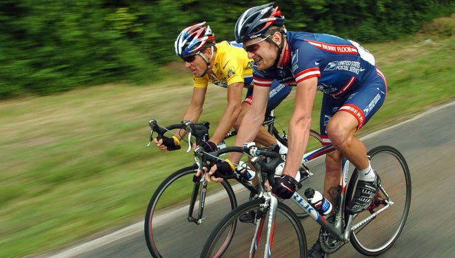Lance Armstrong, left, and Floyd Landis were teammates but could be on the opposite ends of a federal lawsuit.