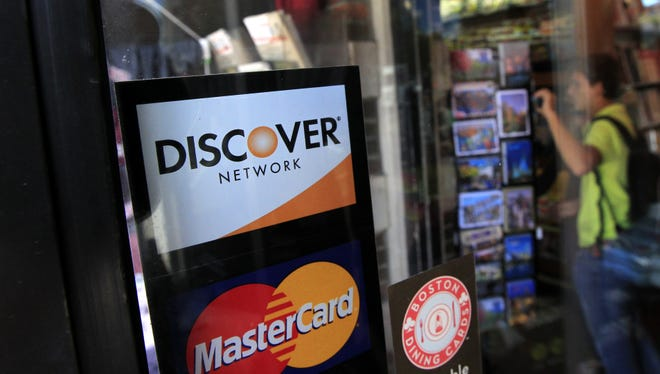 A shop in Cambridge, Mass., displays which  credit cards are accepted at the store.