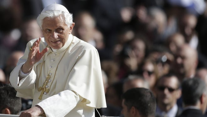 Pope Benedict XVI blesses the faithful during the weekly general audience in St. Peter's square at the Vatican, Oct. 10, 2012.