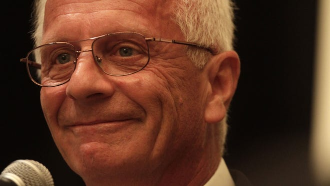 Republican nominee winner Kerry Bentivolio celebrates his win over candidate Nancy Cassis on Aug. 7.