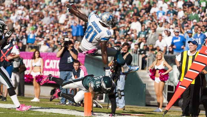 Detroit's Calvin Johnson is knocked out of bounds at the 1-yard line by Eagles free safety Kurt Coleman during the fourth quarter.