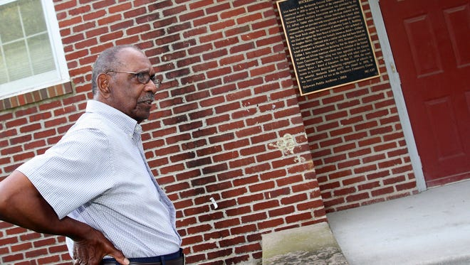 Robert Fleming stands in front of Hockessin School 107C, which he hopes will be preserved for future generations.