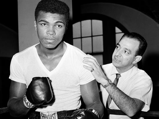 Muhammad Ali was still Cassius Clay when he posed with trainer Angelo Dundee in New York City in 1962.