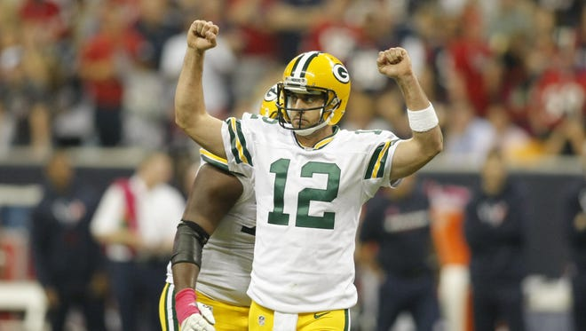 Aaron Rodgers celebrates one of his six touchdown passes.