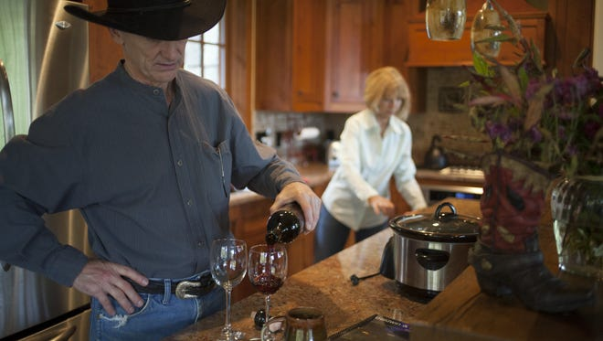 Scott Huse pours wine for himself and his wife, Barbara Matzick Huse, at their home near Sylva, N.C., on Sunday afternoon. They lived together for eight years before marrying in November.