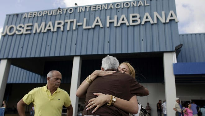 A woman is welcomed by relatives after arriving from U.S. at the Jose Marti airport in Havana in 2009.
