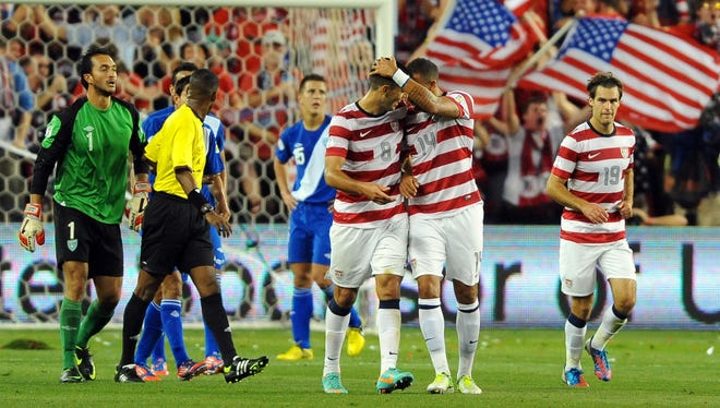 U.S. forward Clint Dempsey (8) is congratulated by midfielder Danny Williams (14) during the first half of the World Cup qualifying match against Guatemala.