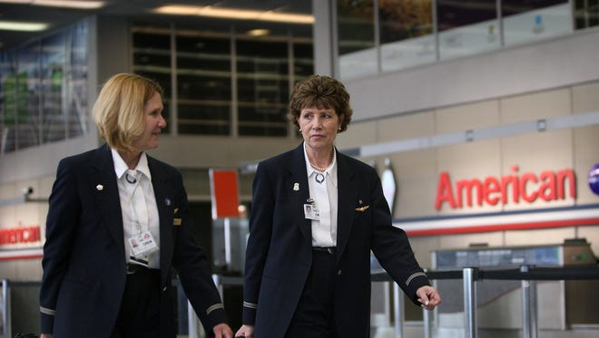 American Airlines flight attendants arrive for work at O'Hare International Airport July 2, 2008.