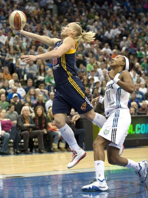 Fever guard Erin Phillips blows by Lynx guard Candice Wiggins for a layup in the fourth quarter of Game 1.