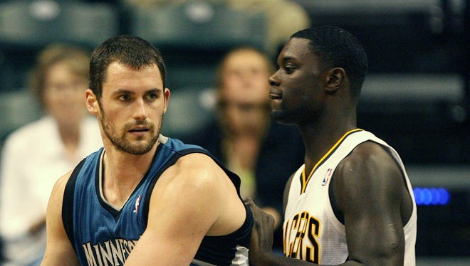 Oct 12, 2012; Indianapolis, IN, USA; Minnesota Timberwolves forward Kevin Love (42) guards Indiana Pacers forward David West (21) at Bankers Life Fieldhouse.  Mandatory Credit: Brian Spurlock-US PRESSWIRE  ORG XMIT: USPW-97838 ORIG FILE ID:  20121012_jla_ss1_208.jpg