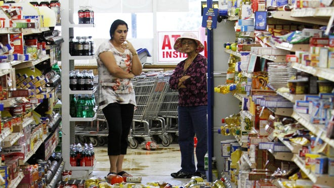 Debris covers the floor of the Miller's Mart food store after an earthquake in Mineral, Va., a small town northwest of Richmond near the earthquake's epicenter on Aug. 23, 2011.