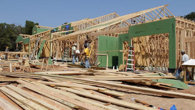 In this Sept. 12, 2012, photo, homes are under construction in Edmond, Okla.
