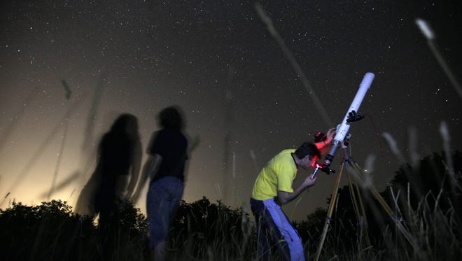 Astronomers observe the night sky for the Perseid meteor shower at an observatory near the village of Avren east of the Bulgarian capital Sofia. Up to 60  falling stars an hour may be visible in the Orionids meteor shower over North America.